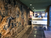 A centuries old tapestry and a futuristic reception desk